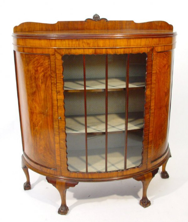 25: 1920s walnut bow fronted china cabinet, the moulded