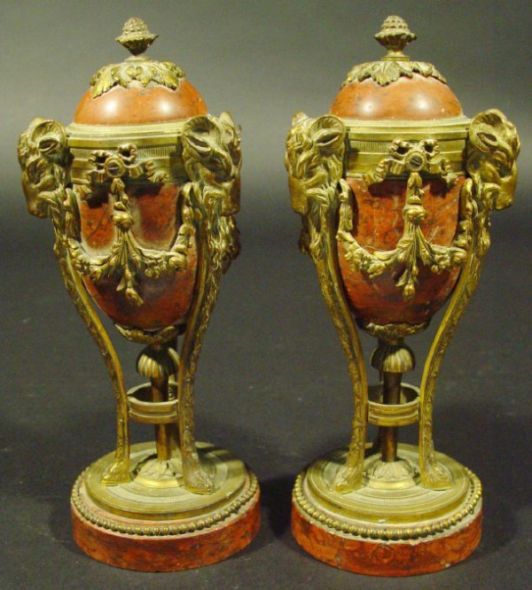 412: Pair of Victorian ormolu and red marble urns, the