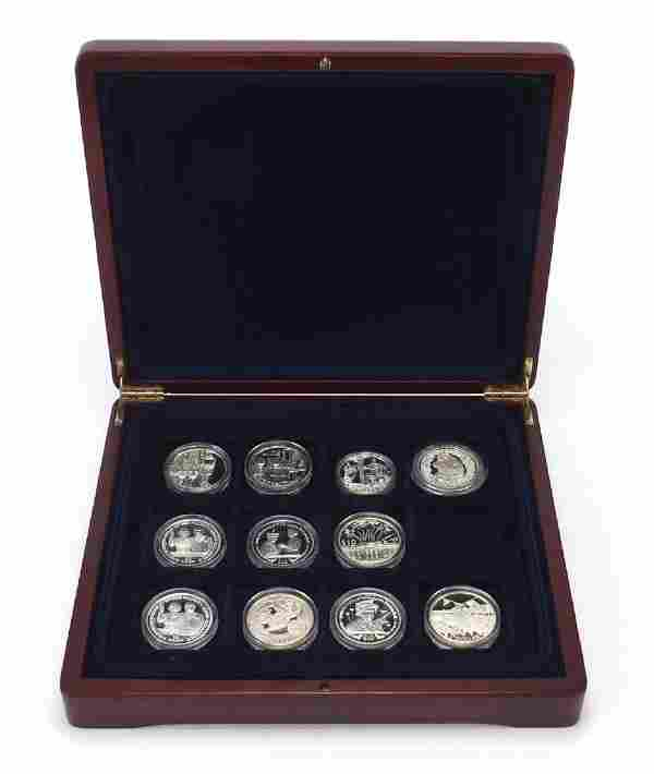 Eleven commemorative silver proof coins including HM