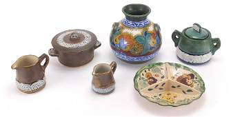 Quimper and Gouda pottery comprising a vase with twin