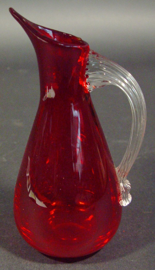 1213: Whitefriars ruby glass jug with clear handle, 17c