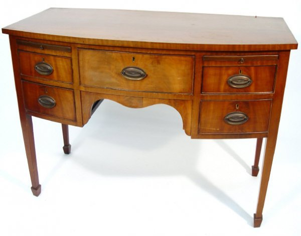 2: 19th Century mahogany bow fronted sideboard, the cen