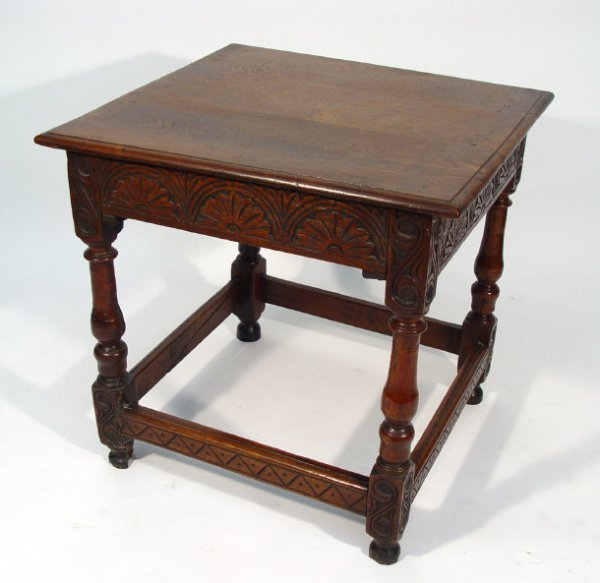 6: Square oak side table fitted with a floral carved fr