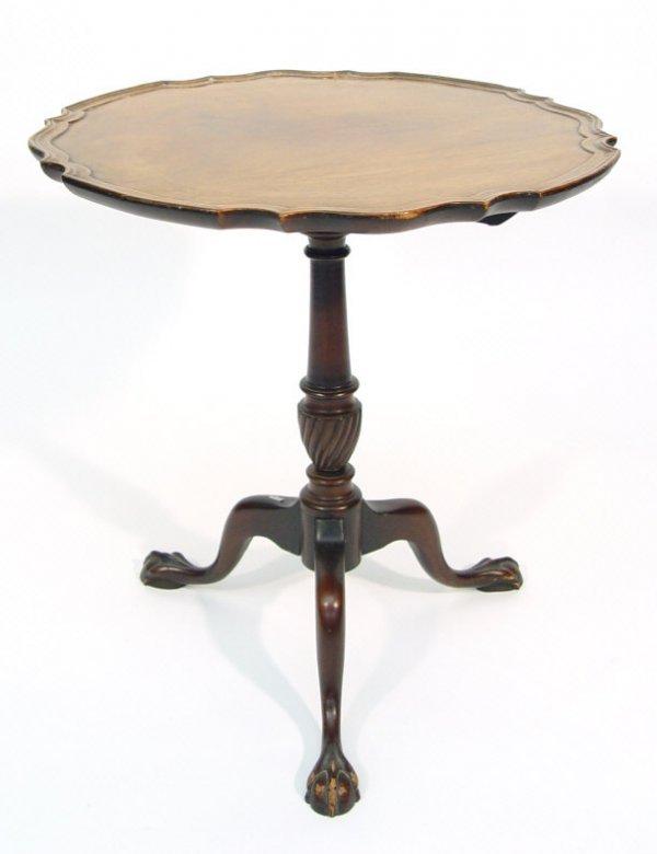 8: Mahogany snap top tripod table, the moulded circular