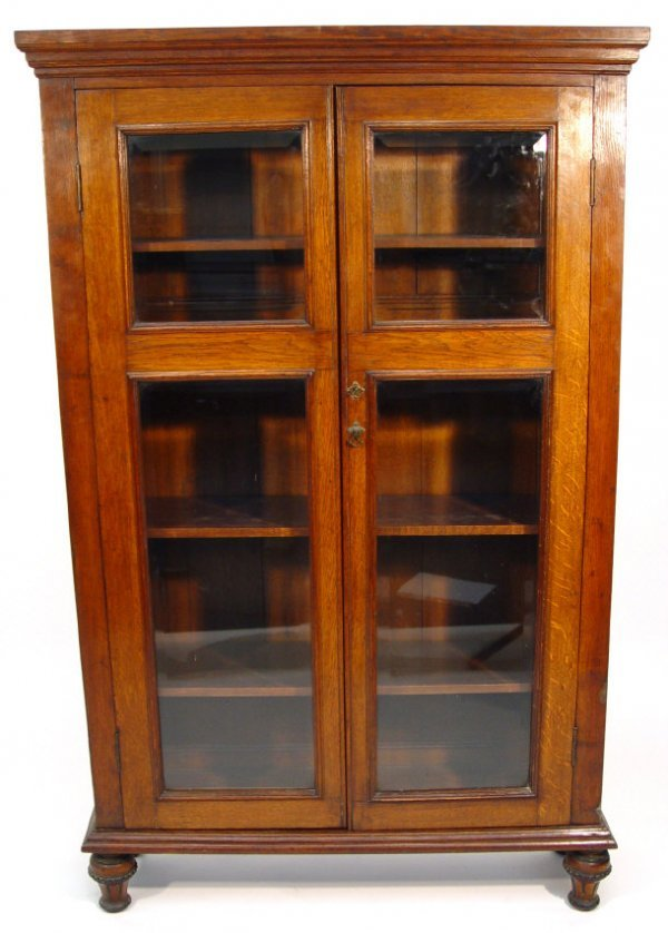 13: Edwardian oak bookcase with moulded cornice above a