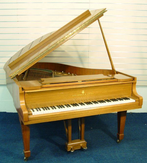 19: Steinway and Sons walnut cased baby grand piano num