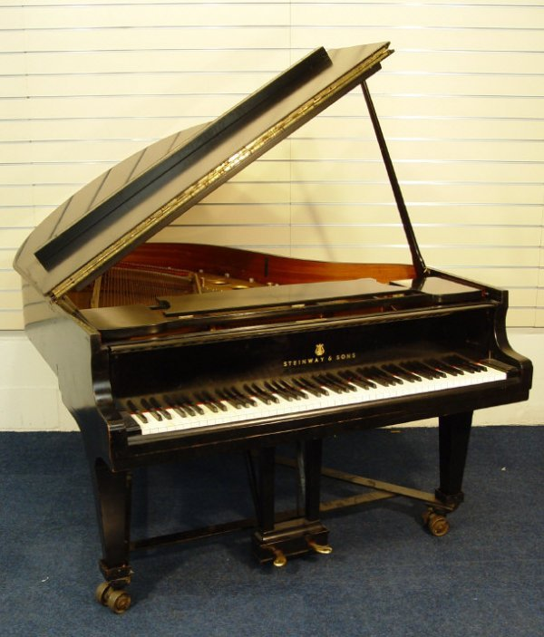 20: Steinway and Sons baby grand piano with ebonised ca