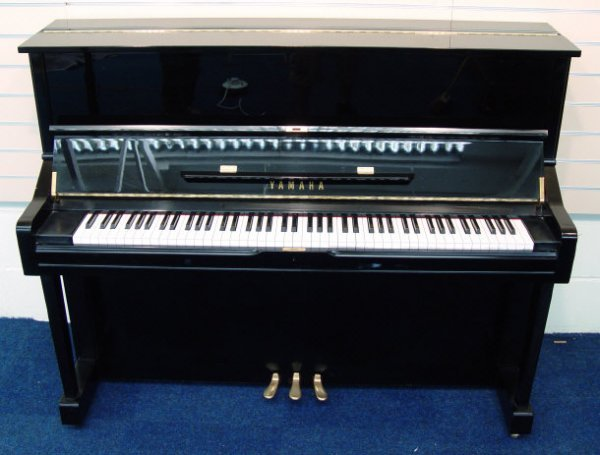 21: Yamaha upright piano with ebonized case, factory ma