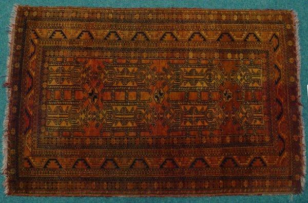 24: Rectangular orange and brown ground rug decorated w