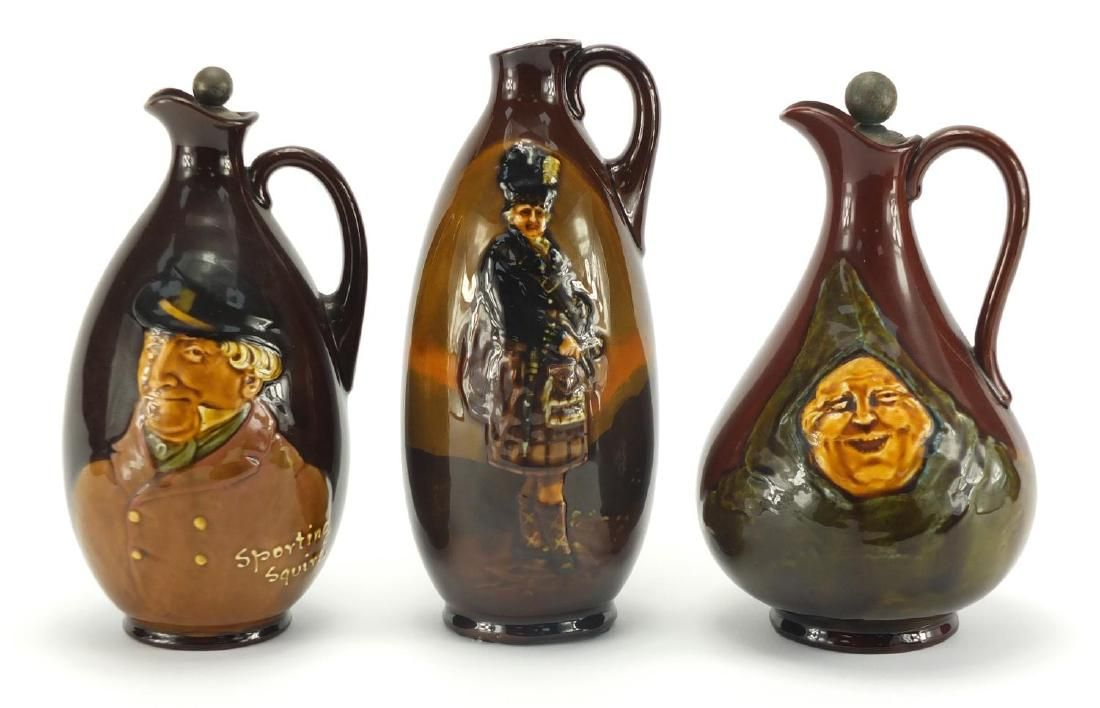 Three Royal Doulton Kingsware Dewar's Whisky decanters,