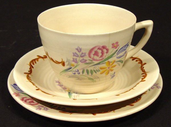 1206: Clarice Cliff china trio decorated with floral sp