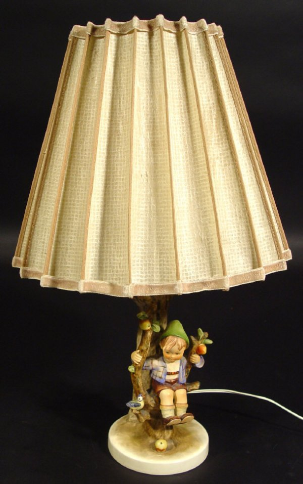 1215: Hummel table lamp modelled with a young boy on th
