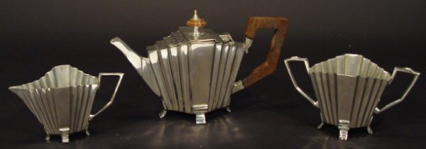 1222: Art Deco design silver metal three piece tea serv