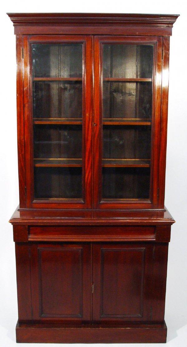9: Victorian mahogany bookcase, the moulded cornice abo