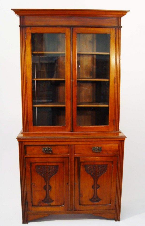 17: Victorian walnut bookcase, the moulded cornice abov