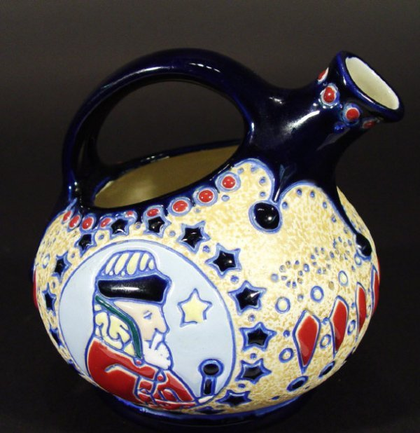 1216: Amphora pottery ewer enamelled with a Wise Man an