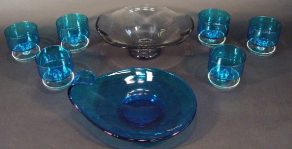 1224: Six 1970s blue glass sundae dishes and a similar