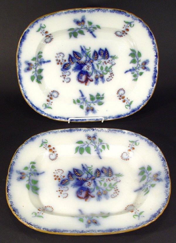 1276: Two Victorian flow blue meat plates, each decorat
