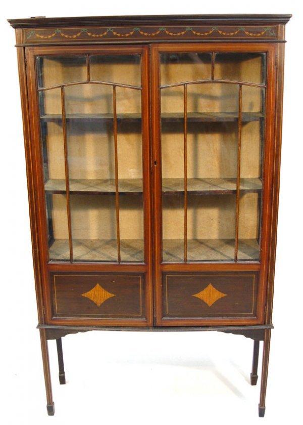7: Edwardian inlaid mahogany china cabinet, the moulded