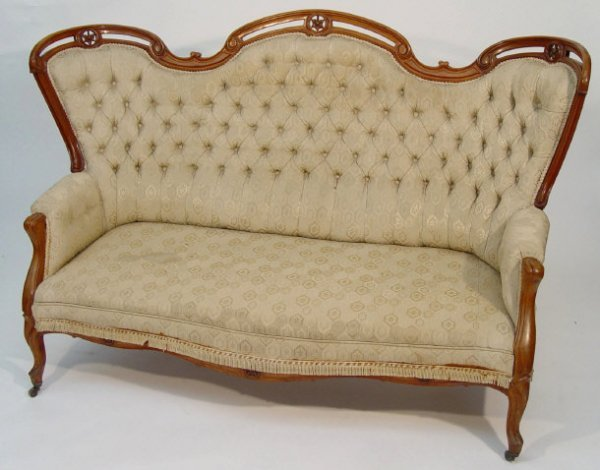 16: Victorian walnut framed settee with serpentine fron
