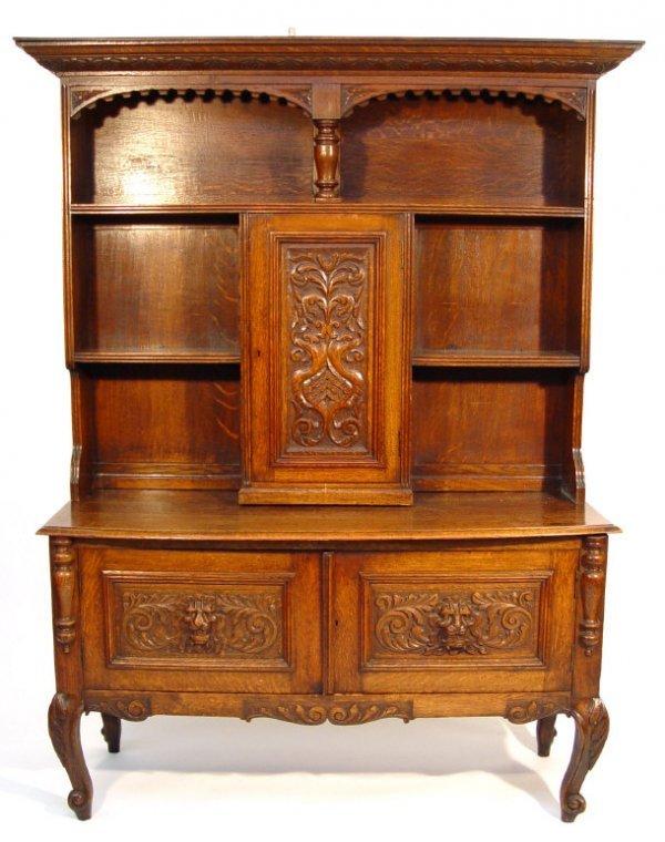 17: Oak dresser, the moulded cornice with foliate carve