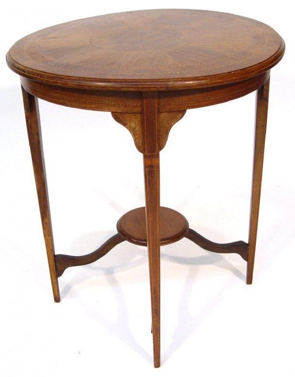 20: Edwardian circular mahogany side table with underti