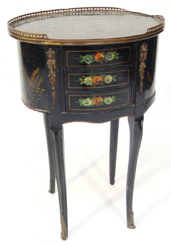 23: Oval black lacquered chest with pierced brass galle