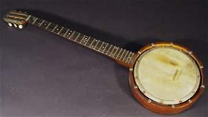 489 Inlaid mahogany banjo with mother of pearl inlaid