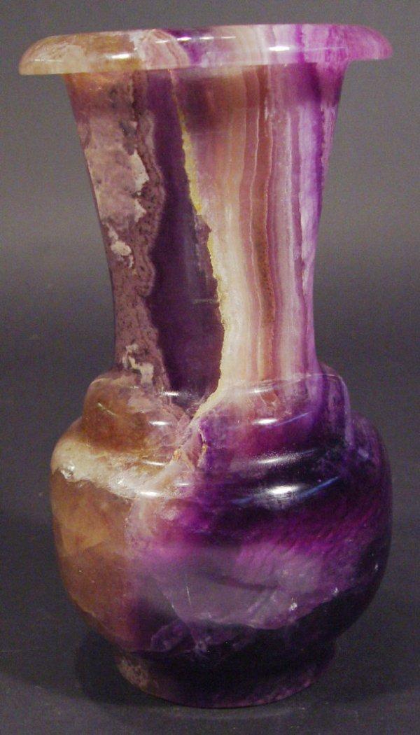 568: Turned bluejohn vase, 23cm high