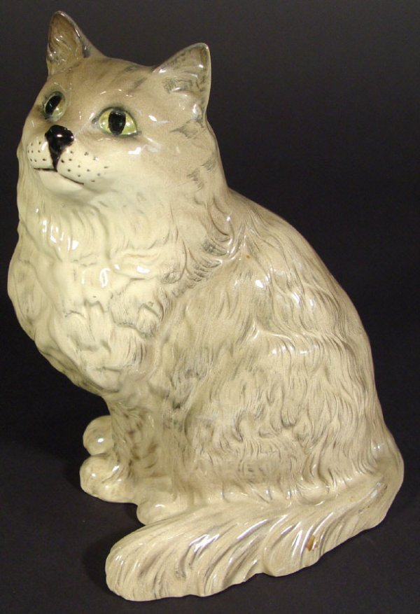 1202: Royal Doulton seated china cat painted in grey, p