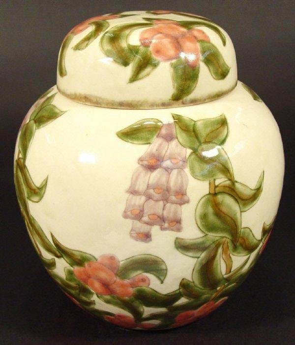 1212: Cobridge stoneware ginger jar and cover, hand pai