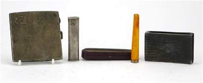 Smoking objects including a Dunhill pocket lighter with