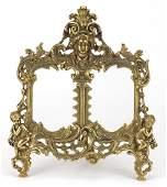 Ornate gilt brass strut double photo frame, cast in