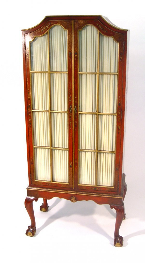 6: Scarlet lacquered bookcase, fitted with a pair of gl