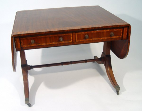 9: Mahogany dropleaf sofa table with crossbanded top an