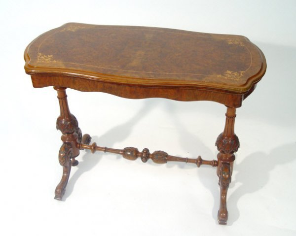 12: Victorian burr walnut card table, the strung inlaid
