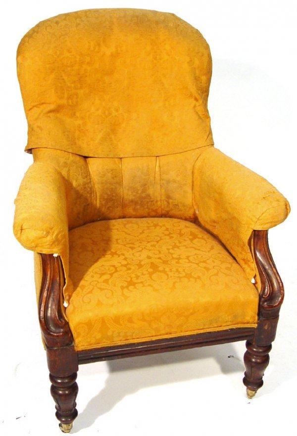 15: Victorian mahogany framed armchair on brass castors