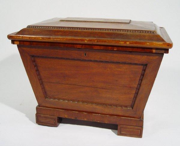 18: 19th century sarcophagus-shaped mahogany wine coole