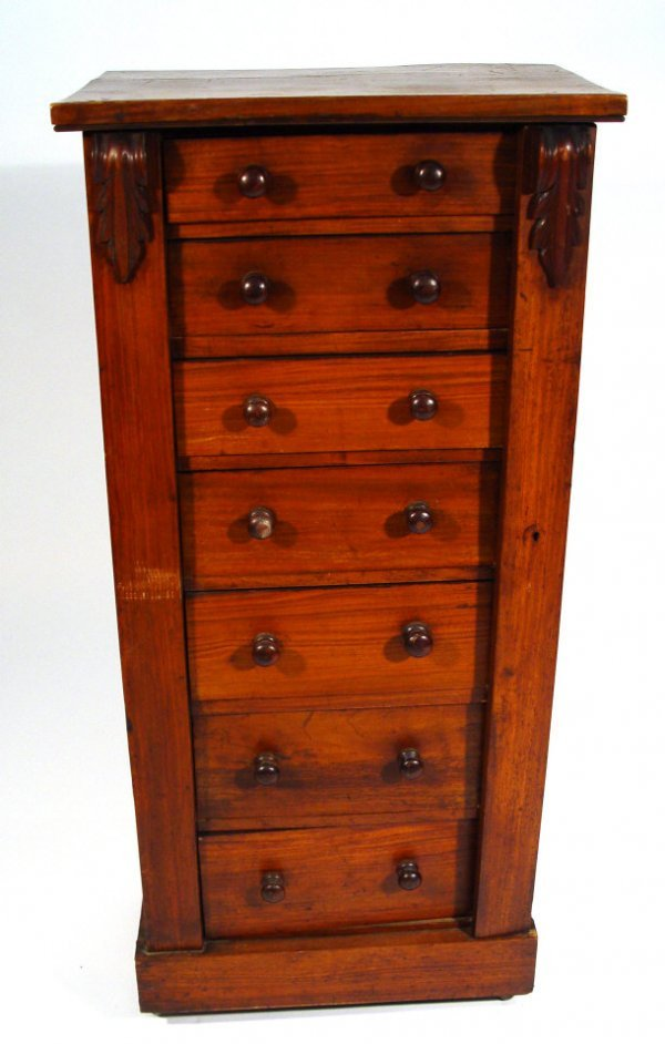 23: Victorian walnut Wellington chest, fitted with seve