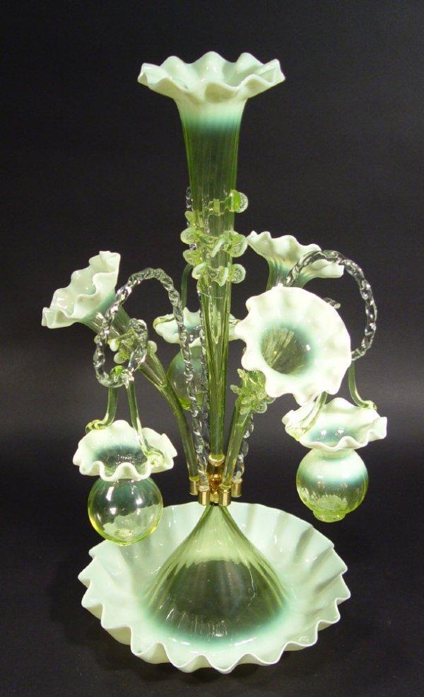 152: Green vaseline glass epergne, the circular base wi