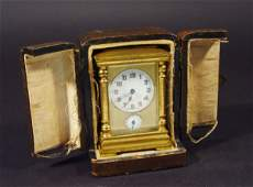 896: Miniature brass cased carriage clock with French a