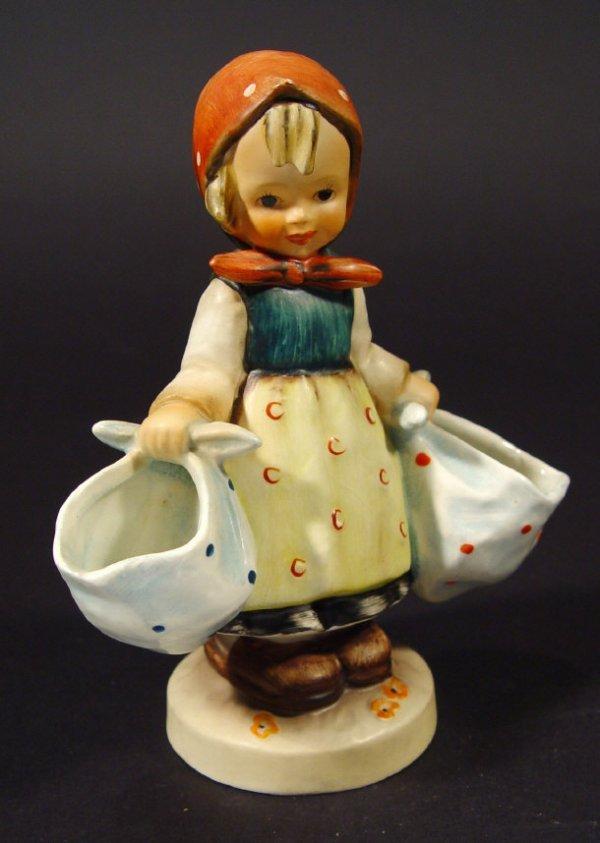 1201: Goebel Hummel china figurine of a young girl carr