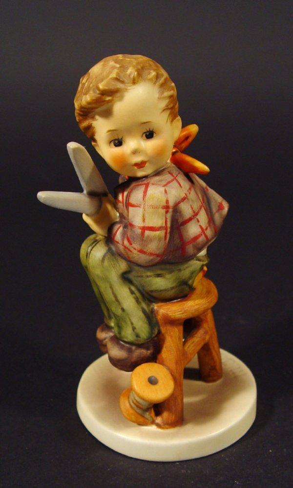 1212: Goebel Hummel china figurine 'Little Tailor', wit
