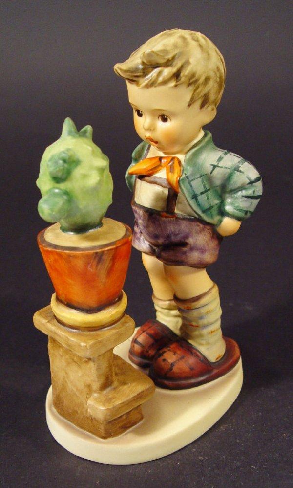 1215: Goebel Hummel china figurine 'Confidentially', wi