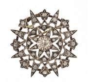 Antique unmarked gold diamond four tier star burst