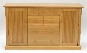 Contemporary light oak sideboard fitted with four