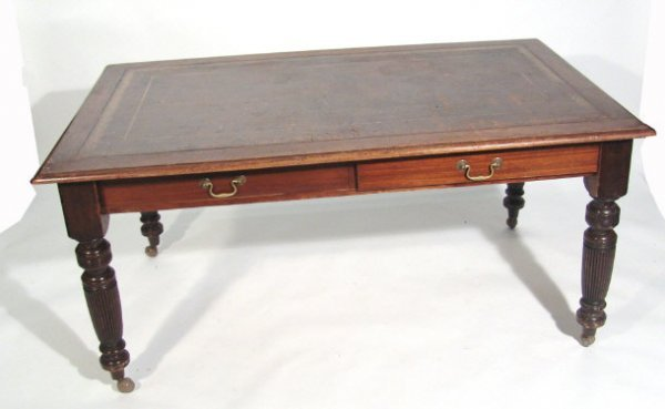 7: Victorian mahogany library table, the top with toole