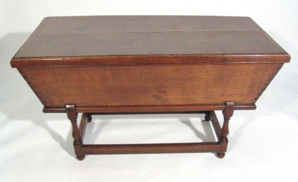 13: Oak sarcophagus shaped dough bin with baluster turn