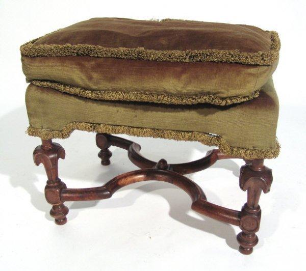 14: Rectangular walnut framed stool, the carved legs su