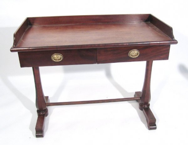 16: Victorian mahogany writing table, the galleried top
